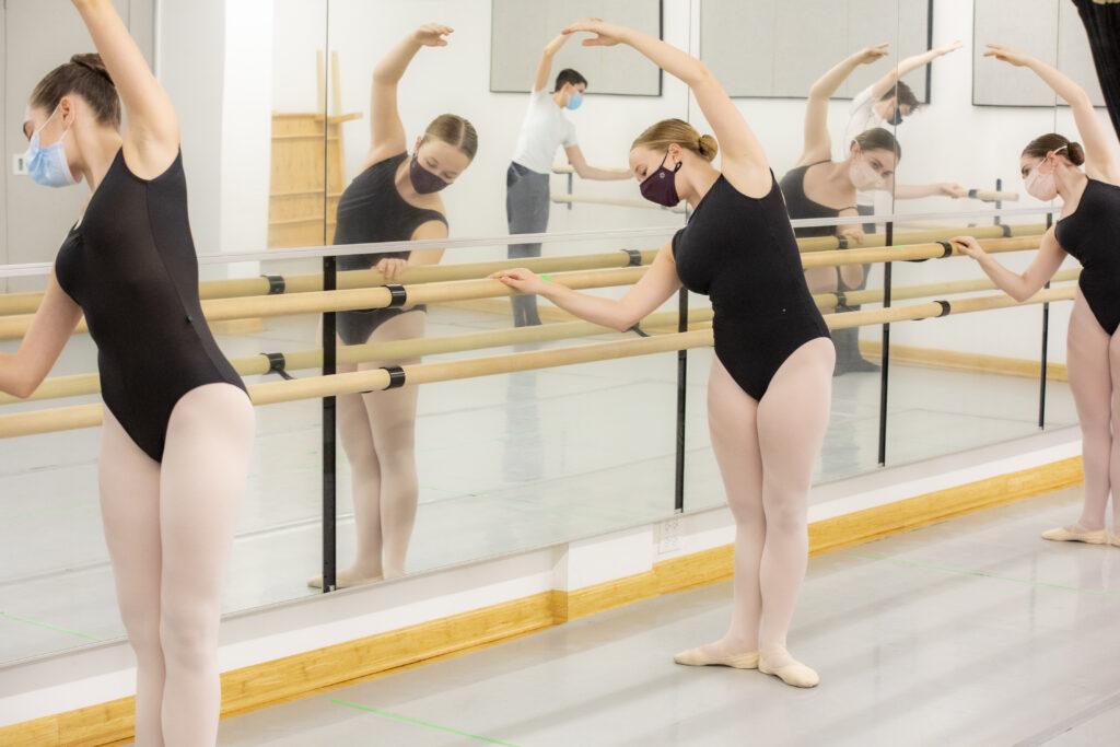 Ballet dancers doing barre exercises.